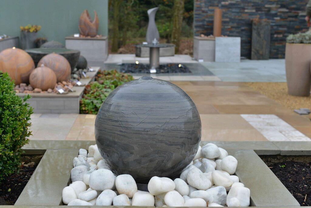 Sphere water feature in shark sandstone